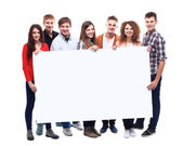 Friends holding banner — Stock Photo