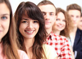Happy students standing In row — Stock Photo