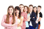 Smiling students standing In row — Stock Photo