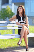 Woman drinking coffee in park — Stock Photo