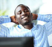 Businessman relaxing in office — Foto Stock
