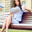 Businesswoman reading newspaper — Stock Photo #45959915