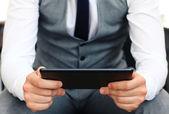Businessman holding digital tablet. — Stock Photo
