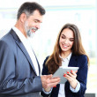 Business partners  using touchpad — Stock Photo #48175645