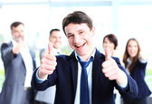 Businessman showing thumbs up — Stock Photo