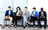 Businesspeople waiting for job interview — Stock Photo