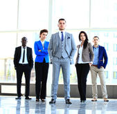 Business team looking at camera — Stock Photo