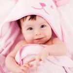 Smiling baby under blanket — Stock Photo