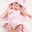 Smiling baby under blanket — Stock Photo #51681501