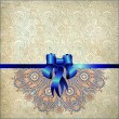 Holiday background with blue ribbon — Stock Photo