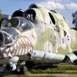 Old Soviet military helicopter MI-24 with bullet prints on glas - Stock Photo