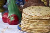 Shrovetide pancakes on a festive table — Stock Photo
