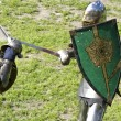 Stock Photo: Duel of knights in jousting tournament