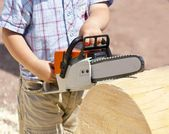 Toy chainsaw in the hands of the child — Stock Photo