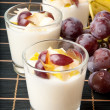 Fresh pear and grape yogurt in glass — Stock Photo #12088858