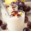 Fresh pear and grape yogurt in glass — Stock Photo