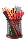 Holder with scissors and colored pencils on a white background — Stock Photo