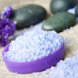 Spa concept. Lavender salt and purple flowers - Stock Photo