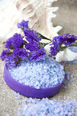 Spa concept. Lavender salt and purple flowers — Stock Photo