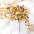 Stock Photo: Gold ribbon gift with festive holiday background