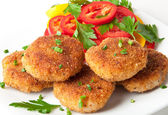 Chicken cutlets with vegetables and herbs — Stock Photo