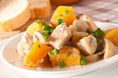 Stew chicken with vegetables and mushrooms in a cream sauce — Stock Photo