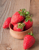 Close up of strawberry on wooden background — Stock Photo