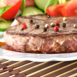 Closeup of grilled beef steak with fresh vegetables - Stok fotoğraf