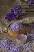 Spa concept. Lavender salt and purple flowers — Stock Photo