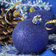 Blue Christmas balls on a blue background — Stock fotografie