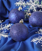 Blue Christmas balls on a blue background — Stock Photo