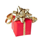 Gift wrapped with golden bow, white background — Stock Photo