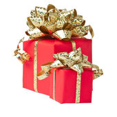 Two gifts wrapped with golden bow, white background — Stock Photo