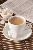 Cup of coffee, sugar and newspaper closeup — Stock Photo