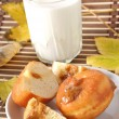 Stock Photo: Breakfast. Glass of milk and donut