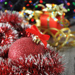 Christmas ball and presents — Stock Photo