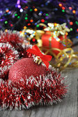 Christmas ball and presents — Stock Photo