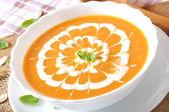 Cream of pumpkin soup with sour cream sauce — Stock Photo