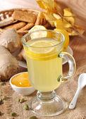 Healthy ginger tea with lemon and honey on the table — Stock Photo