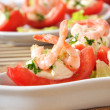 Halves of tomatoes filled with shrimp cocktail — Stock Photo