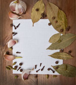 Paper for recipes and spices on an old wooden table — Stock Photo