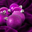Violet Christmas balls on a violet background — ストック写真