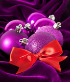 Violet Christmas balls on a violet background — Stock Photo