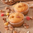 Stock Photo: Muffins with nuts and raisins