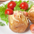 Baked potato with sausages and salad - Stock Photo