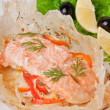 Baked salmon with vegetables in an envelope — Stock Photo