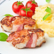 Grilled chicken patties wrapped strips of bacon and mashed potatoes — Stock Photo
