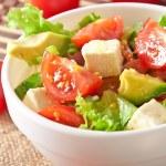 Salad with avocado, cherry tomatoes and mozzarella with honey-bacon dressing — Stock Photo