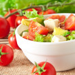 Salad with avocado, cherry tomatoes and mozzarella with honey-bacon dressing — Stok fotoğraf