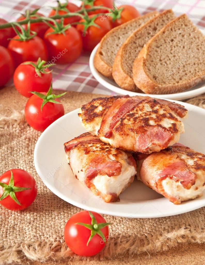 Grilled chicken patties wrapped strips of bacon — Stock Photo #18057549